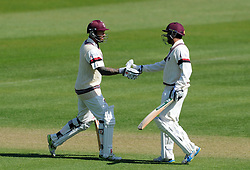 Somerset's Peter Trego celebrates his half century with Abdur Rehman- Photo mandatory by-line: Harry Trump/JMP - Mobile: 07966 386802 - 14/04/15 - SPORT - CRICKET - LVCC County Championship - Day 3 - Somerset v Durham - The County Ground, Taunton, England.