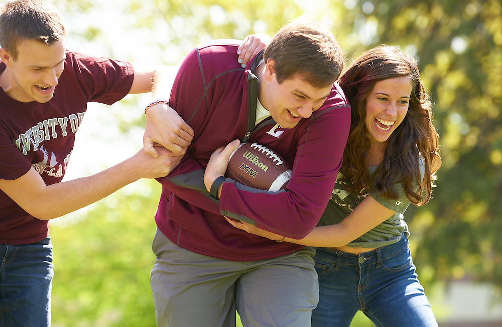 Josh Stanke; Katie Rascher; Bryce Hartl; Football soccer; Activity; Playing; Smiling; Buildings; Coate Hall; Eagle Hall; Location; Outside; People; Woman Women; Man Men; Student Students; Spring; May; Time/Weather; sunny; Type of Photography; Candid; UWL UW-L UW-La Crosse University of Wisconsin-La Crosse; Lifestyle
