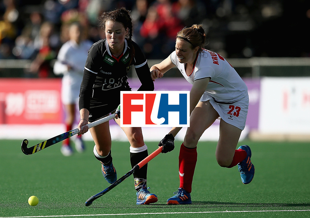 JOHANNESBURG, SOUTH AFRICA - JULY 08:  Amelie Wortmann of Germany and Marta Kruszynski of Poland battle for possession during the pool A match between Germany and Poland on day one of the FIH Hockey World League Semi-Final at Wits University on July 8, 2017 in Johannesburg, South Africa.  (Photo by Jan Kruger/Getty Images for FIH)