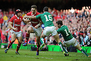 George North of Wales runs in to Ireland's Rob Kearney and Craig Gilroy (14). RBS Six nations championship, Wales v Ireland at the Millennium stadium in Cardiff, South Wales on Saturday 2nd Feb 2013. pic by Andrew Orchard, Andrew Orchard sports photography,