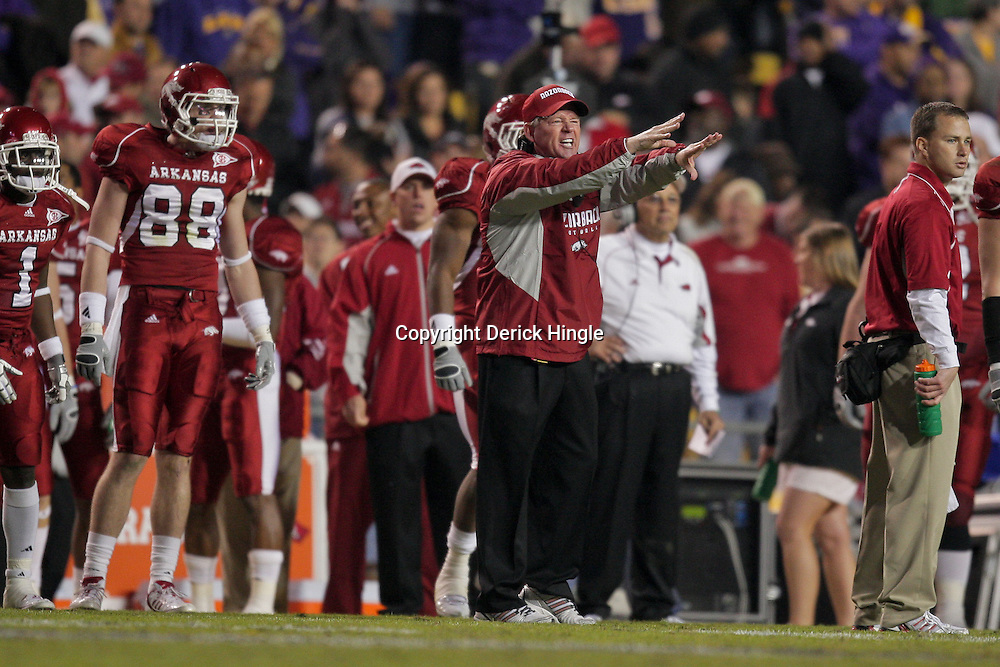 Nov 28, 2009; Baton Rouge, LA, USA; Arkansas Razorbacks head coach Bobby Petrino reacts to an officials call on the sideline during the second half against the LSU Tigers at Tiger Stadium. LSU defeated Arkansas in overtime 33-30. Mandatory Credit: Derick E. Hingle-US PRESSWIRE