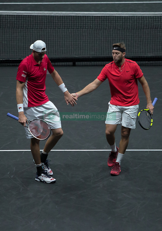 September 24, 2017 - Prague, Czech Republic - John Isner and Jack Sock of Team World celebrate during there mens doubles match between Tomas Berdych and Marin Cilic of Team Europe on the final day of the Laver cup on September 24, 2017 in Prague, Czech Republic. The Laver Cup consists of six European players competing against their counterparts from the rest of the World. Europe will be captained by Bjorn Borg and John McEnroe will captain the Rest of the World team. The event runs from 22-24 September. (Credit Image: © Robert Szaniszlo/NurPhoto via ZUMA Press)