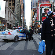 A strong police presence during Super Bowl week activities in Times Square, New York, USA. 29th January 2014. Photo Tim Clayton