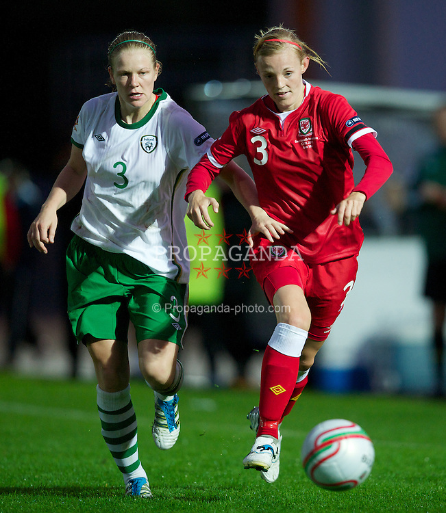 NEWPORT, WALES - Saturday, September 17, 2011: Wales' Sophie Ingle (Cardiff City) in action against the Republic of Ireland's Diane Caldwell (Thor) during the UEFA European Women's Championship 2011-13 Group 4 Qualifying match at the Newport Stadium. (Pic by David Rawcliffe/Propaganda)