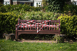 "@Licensed to London News Pictures 16/04/2020 Downe, Kent. As the lockdown continues for several more weeks a traditional communal bench, where local villagers would congregate, is taped up with hazard tape and a label advising ""Please do not congregate here"". As part of the government advice to everyone the local Downe Residents Association encourages the local villagers to maintain their safety through social-distancing during the Covid-19 pandemic. Photo credit: Manu Palomeque/LNP"