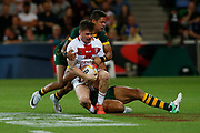 John Bateman of England gets tackled Dane Gagai of Australia during the Rugby League World Cup match between Australia and England at Melbourne Rectangular Stadium, Melbourne, Australia on 27 October 2017. Photo by Mark  Witte.