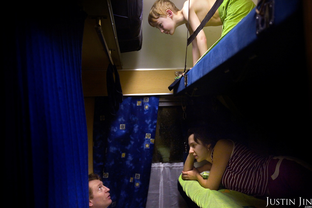 A family on a train across Russia. The train, beginning in Berlin, Germany, goes through Poland and Belarus, and ends in Irkutsk, Russia. The entire journey takes six days.