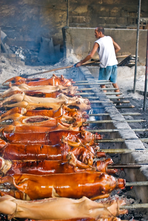 Lechon (roast pig) for sale, cooked before your eyes, La Loma, Quezon City, Philippines