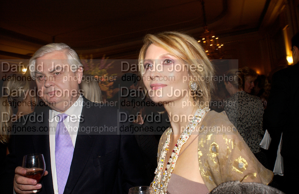 Lord Norman Lamont and Sari Akhavan, Bruce Oldfield celebrates the publication of 'Rootless' party in aid of Crimestoppers. Claridges. 22 September 2004. SUPPLIED FOR ONE-TIME USE ONLY-DO NOT ARCHIVE. © Copyright Photograph by Dafydd Jones 66 Stockwell Park Rd. London SW9 0DA Tel 020 7733 0108 www.dafjones.com