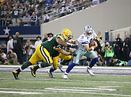 Dallas Cowboys quarterback Tony Romo (9) is sacked by Green Bay Packers defensive end Datone Jones (95) and Green Bay Packers outside linebacker Clay Matthews (52) during the Green Bay Packers against the Dallas Cowboys  NFL game in Dallas, Texas Sunday, December, 15, 2013. (AP Photo/Tom Hauck)