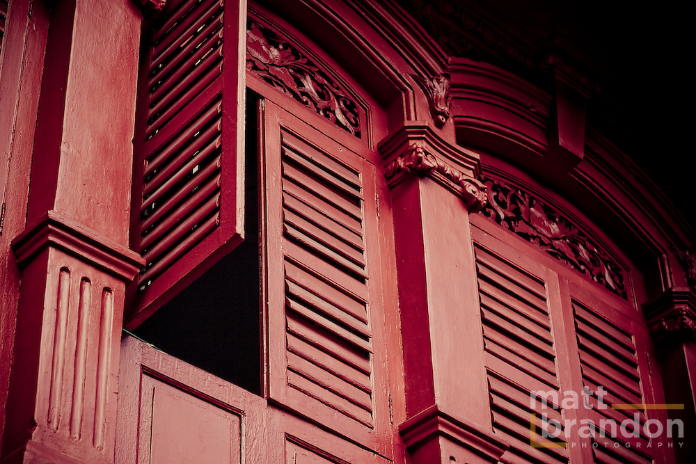 An open red shutter in an old colonial house in downtown Georgetown, Penang.
