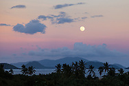The full moon coordinates with sunset over Pillsbury Sound on the east end of St. Thomas, US Virgin Islands. The image was captured from the now extinct Torcido Taco.