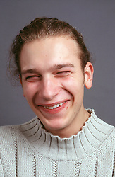 Portrait of young man laughing,