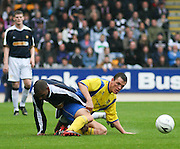 St Johnstone's Martin Hardie tackles Dundee's Freddie Daquin - St Johnstone v Dundee, McDiarmid Park, Perth, 18/08/2007