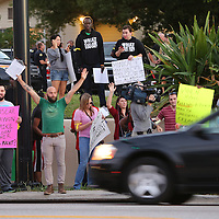 Protesters gather on S.R. 50 in downtown Orlando to protest nationwide police brutality on Thursday, December 4, 2014 in Orlando, Florida. The Eric Garner choking incident and the Mike Brown shooting grand jury decision were the main reason the protesters decided to shut down the major roadway in downtown Orlando, which they did for about 15 minutes until City of Orlando police officers responded peacefully and controlled the area.  (Photo/Alex Menendez)