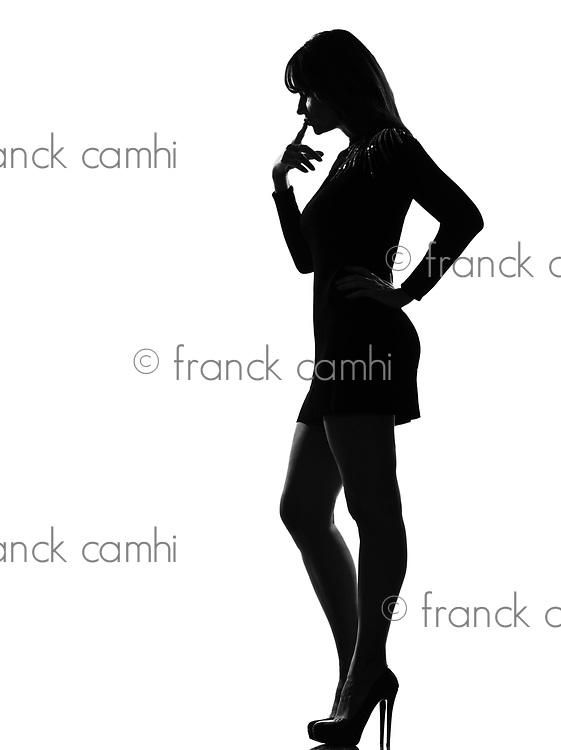 stylish silhouette caucasian beautiful woman full length thinking pensive on studio isolated white background