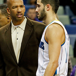 February 2, 2012; New Orleans, LA, USA; New Orleans Hornets head coach Monty Williams talks to point guard Greivis Vasquez (21) following a loss to the Phoenix Suns at the New Orleans Arena. The Suns defeated the Hornets 120-103.  Mandatory Credit: Derick E. Hingle-US PRESSWIRE