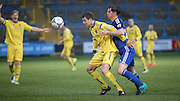 Ben Clappison (Halifax) is stopped from reaching the ball by Anthony Dudley (Guiseley) during the Conference Premier League match between FC Halifax Town and Guiseley at the Shay, Halifax, United Kingdom on 5 December 2015. Photo by Mark P Doherty.