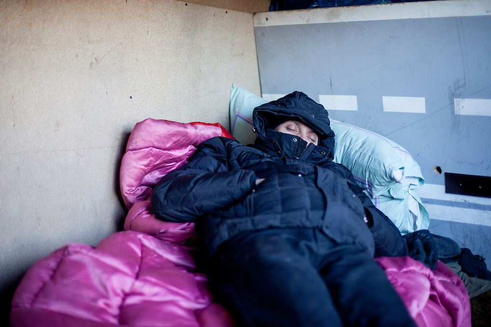 "Activist Andrej having a nap at the barrikades blocking a building supplies store named ""Epicenter"" in the city of Lviv, Ukraine."