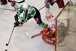 Tomi Mustonen (HDD Tilia Olimpija, #21) vs Jaakko Soumalainen (HK Acroni Jesenice, #31) during ice-hockey match between HD Tilia Olimpija and HK Acroni Jesenice  in 6th Round of EBEL league, on September 26, 2010 at Hala Tivoli, Ljubljana, Slovenia. (Photo By Matic Klansek Velej / Sportida.com)