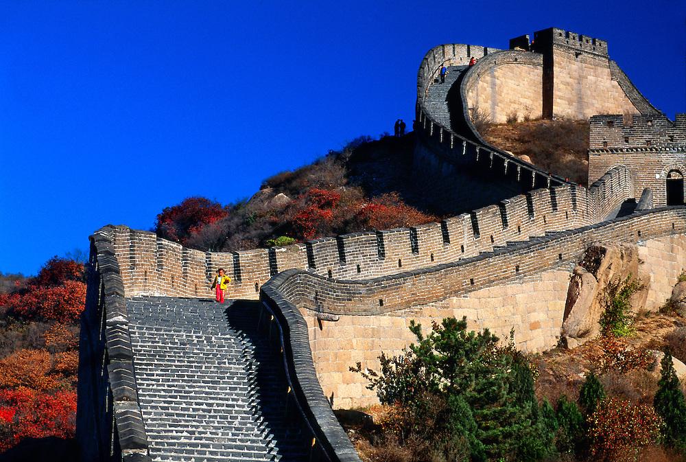 Little Chinese girl running down the steps, Great Wall of China at Badaling, China