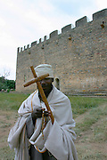 AXUM, TIGRAY/ETHIOPIA..Orthodox priest in front of the first Church of St. Mary of Zion..(Photo by Heimo Aga)