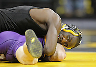 December 8, 2011: Iowa Hawkeyes Montell Marion glances up at the clock as he works on Northern Iowa Panthers Seth Noble in the 141 pound bout of the NCAA wrestling dual between the Northern Iowa Panthers and the Iowa Hawkeyes at Carver-Hawkeye Arena in Iowa CIty, Iowa on Thursday, December 8, 2011. Marion defeated Noble 18-8 and Iowa defeated Northern Iowa 38-4.