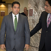 FORT LAUDERDALE, FLORIDA, DECEMBER 21, 2015<br /> Suspended Broward Sheriff's deputy Peter Peraza, left, and his attorney, Eric Schwartzreich, outside the courtroom following a brief court appearance. Peraza faces manslaughter charges in the shooting death of Jermaine McBean, 33, in July of 2013.<br /> (Photo by Angel Valentin/Freelance).