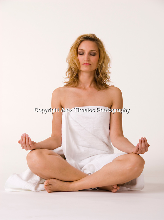 Young Woman covered in a white towel enjoying wellness