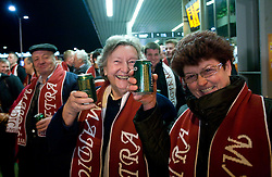 Fans of Slovenian athlete Petra Majdic drinking beer when she arrived home with cristal globus at the end of the nordic season 2008/2009, on March 23, 2009, at airport Jozeta Pucnika, Brnik, Slovenia. (Photo by Vid Ponikvar / Sportida)