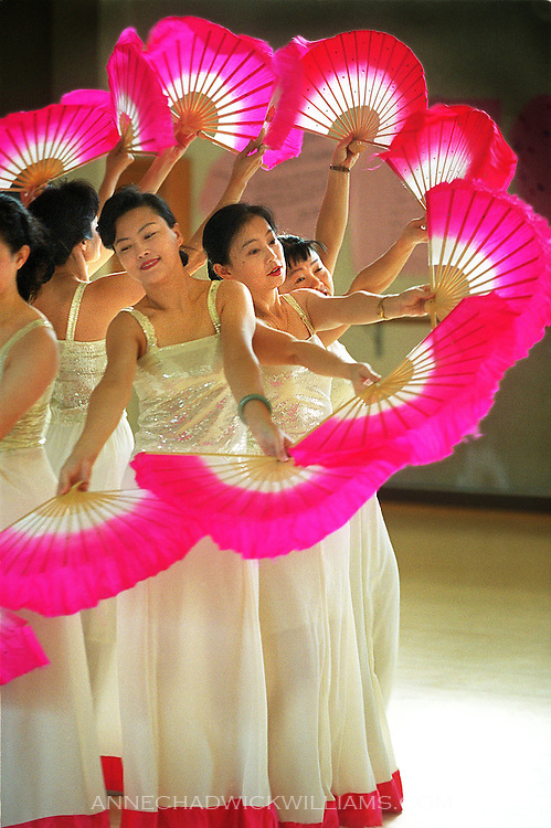 Chinese fan dancers practice at Sacramento High School gym in preparation for the  fourth annual Chinese New Year's Festival in Sacramento, CA. The group consists of 10 women who come together this time of year to dance at the festival. January 12, 2001.