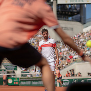 PARIS, FRANCE June 01. Pablo Cuevas of Uruguay in is passed by Dominic Thiem of Austria as the Baal boy reaches for the ball during the Men's Singles third round match on Court Suzanne Lenglen at the 2019 French Open Tennis Tournament at Roland Garros on June 1st 2019 in Paris, France. (Photo by Tim Clayton/Corbis via Getty Images)