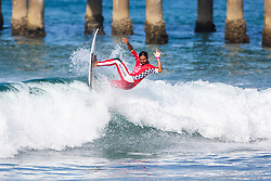 Oney Anwar (IDN) advances to Round 2 of the 2018 VANS US Open of Surfing after winning Heat 3 of Round 1 at Huntington Beach, California, USA.