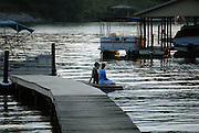 LAKE NORMAN - A couple enjoys dusk on a Lake Norman Dock -  photo by Laura Mueller