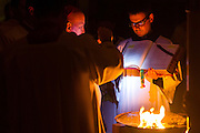 DENVER, CO - APRIL 19: Archbishop Samuel J. Aquila, left, reads from scripture, he'd by John Brooks, during the Easter Vigil Mass at the Cathedral Basilica of the Immaculate Conception on April 19, 2014, in Denver, Colorado. (Photo by Daniel Petty/Denver Catholic Register)