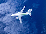 Airliner in flight over the clouds