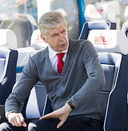 Arsene Wenger of Arsenal sits on the bench and talks to staff before the Premier League match at the John Smiths Stadium, Huddersfield<br /> Picture by James Wilson/Focus Images Ltd 07522 978714<br /> 13/05/2018