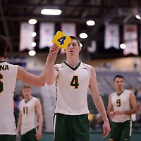 3rd year middle blocker Cody Caldwell (4) of the Regina Cougars in action during Men's Volleyball home game on February 3 at Centre for Kinesiology, Health and Sport. Credit: Arthur Ward/Arthur Images
