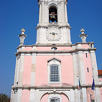 Pousada of Dona Maria Clock Tower in Queluz, Portugal <br /> Torre do Relógio is the name of this 18th century clock and bell tower on a pink, baroque building that is now a luxury hotel in Queluz, Portugal.  It used to be the annex of the National Palace of Queluz which was nicknamed the Portuguese Versailles.