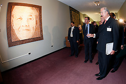 NEW YORK, NY - MAY-13-2007 - King Albert II of Belgium views a portrait of Nelson Mandela which was donated to the U.N. by Belgium, during his visit to the United Nations as Belgium now holds one of the non-permamnent seats on the UN Security Council..(Reporters © Jock Fistick)