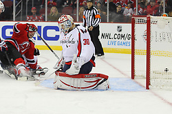 Jan 25, 2013; Newark, NJ, USA; New Jersey Devils right wing Stephen Gionta (11) scores a goal past Washington Capitals goalie Michal Neuvirth (30) during the first period at the Prudential Center.