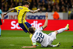 November 20, 2018 - Stockholm, Sweden - Victor Lindelof (L) of Sweden scores a goal as Artem Dzyuba of Russia defends during the UEFA Nations League B Group 2 match between Sweden and Russia on November 20, 2018 at Friends Arena in Stockholm, Sweden. (Credit Image: © Mike Kireev/NurPhoto via ZUMA Press)