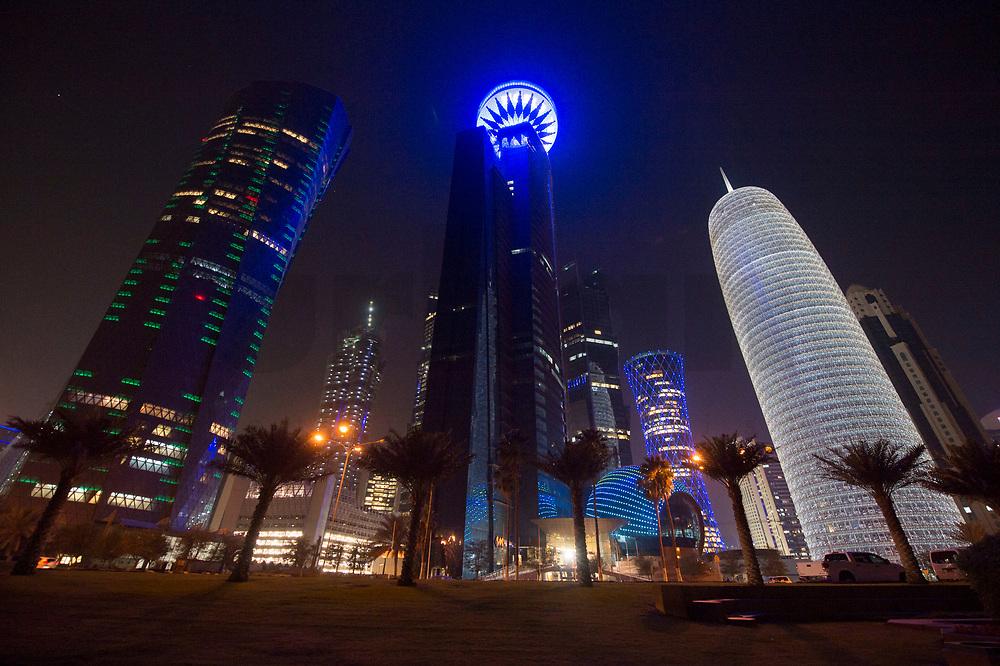 """08 APR 2013, DOHA/QATAR<br /> Al Bidda Tower (links), Qatar World Trade Center (Qatar General Insurance Reinsurance Company) (mitte), Tornado Tower (hinten, blau) und Doha Tower, auch """"Condom Tower"""" (rechts), gesehen von der Al Corniche Street<br /> IMAGE: 20130408-01-043<br /> KEYWORDS: Katar, Hochaus, Wolkenkratzer, Tower, Nacht, night, Nachtaufnahme, Hochhaeuser, Hochäuser, Skyscraper, West Bay, Dwontown Doha"""