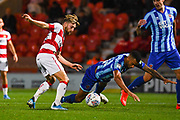 Doncaster Rovers forward Alfie May (19) fouls Blackpool defender Curtis Tilt (16) during the EFL Sky Bet League 1 match between Doncaster Rovers and Blackpool at the Keepmoat Stadium, Doncaster, England on 17 September 2019.