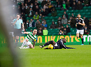 4th April 2018, Celtic Park, Glasgow, Scotland; Scottish Premier League football, Celtic versus Dundee; Scott Brown of Celtic bad challenge on Roarie Deacon of Dundee which earned the Celtic captain a yellow card