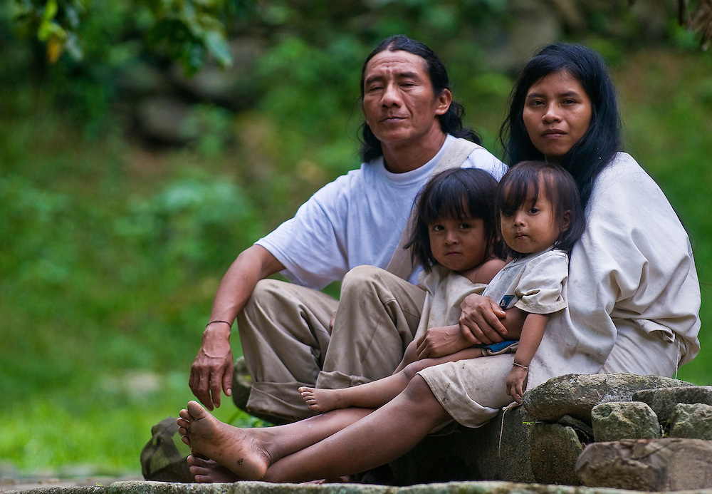 "TAYRONA PARK , COLOMBIA - DECEMBER 17 2010 : Indian family sit together at home in a village in ""Tayrona"" park , Colombia"
