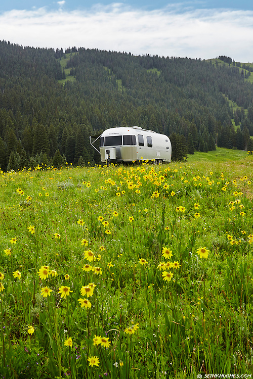 An Airstream trailer camped in a field of wildflowers near Crested Butte, Colordao.