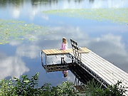 For a kid, you just can't beat bobber fishing on a hot summer afternoon. For me, the innocence captured within this image is very powerful.