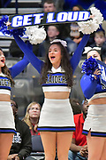 """Middle Tennessee Blue Raiders cheerleader holds a """"Get Loud"""" sign during an NCAA college basketball game against the Mississippi Rebels  in Nashville, Tenn., Friday, Dec. 21, 2018. (Jim Brown/Image of Sport)"""