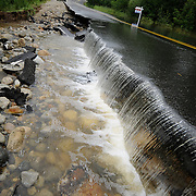 8/8/08 -- FREEPORT, Maine. Flood water rose across the region on Friday, with the worst damage being in Freeport. A section of Desert Road washed away and there were several road closures due to washouts including routes 125 and 136. Photo by Roger S. Duncan.